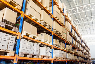 stock-photo-rows-of-shelves-with-boxes-in-factory-warehouse-127809008